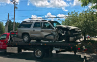 SUV clips telephone pole, sideswipes a car and crashes into brick building!