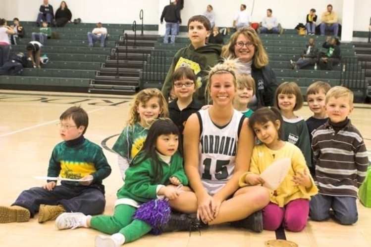 Started a pen pal program in which basketball players wrote back and forth with an elementary class in the district who then attended their pen pal's game.