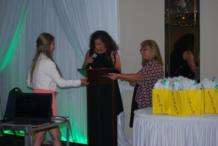 Coach Cormell carried on a tradition started with her basketball program of having an end of season banquet at Gambitta's with a full dinner and a classy way to end the season and recognize the athletes for all of their hard work and achievements. Pictured here is Rachel Vickers receiving an award.