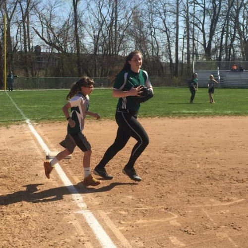 2015 Youth Softball Day-Each player wrote with a pen pal from a 12U travel team who were then recognized at a game and ran onto the field when their player was announced. Pictured is Hannah Stroe with her pen pal.