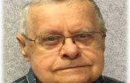 Obituary: CLARENCE J. REZABEK
