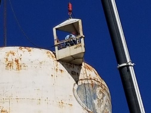 The last signs of the Walton Hills Ford Plant come down as they dismantle the water tower